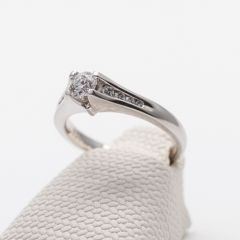 White Gold Round Brilliant and Channel Set Shoulder Ring